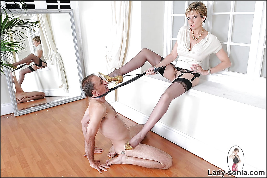 mature femdom whips her manslave and tortures him with her