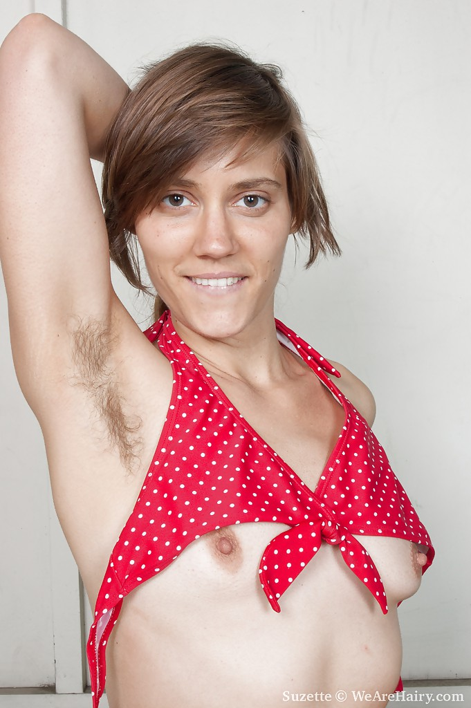 Slender brunette with tiny breasts flaunting her hairy pussy