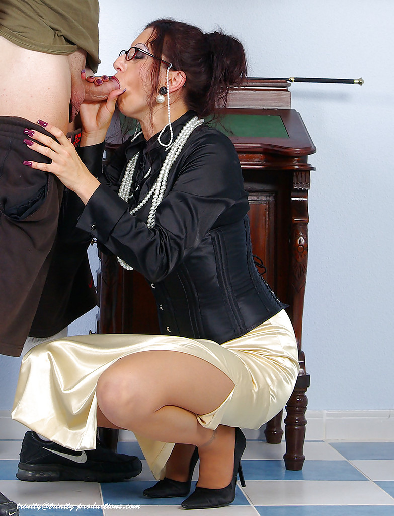 Fully clothed and sucking cock
