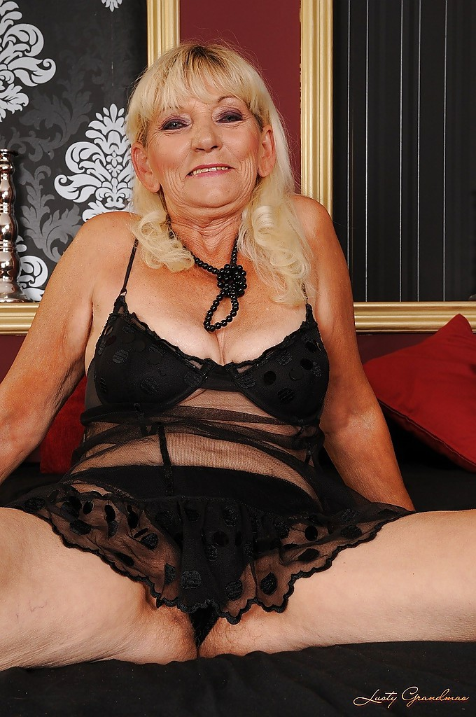 Busty Granny Taking Off Her Lingerie And Posing Naked On The Bed