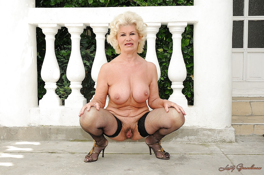 Granny shows boobs outside