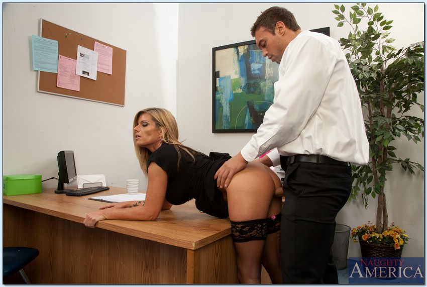 Sexy milf fucked from behind in office