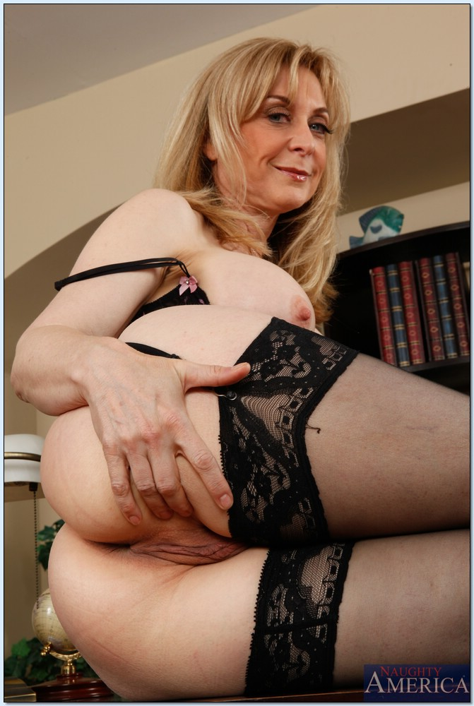 naughty mature lady nina hartley stripping and spreading her legs