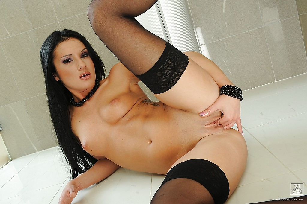 Lusty european brunette Sarah Diamant stripping and fingering her pussy