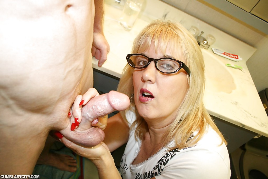 Blonde sucking big cock mature