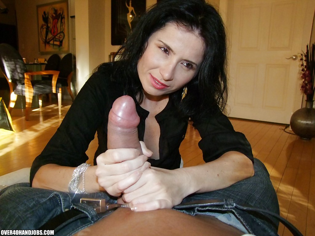 ... Seductive mature brunette gives a handjob and gets a cumshot on her  tits ...