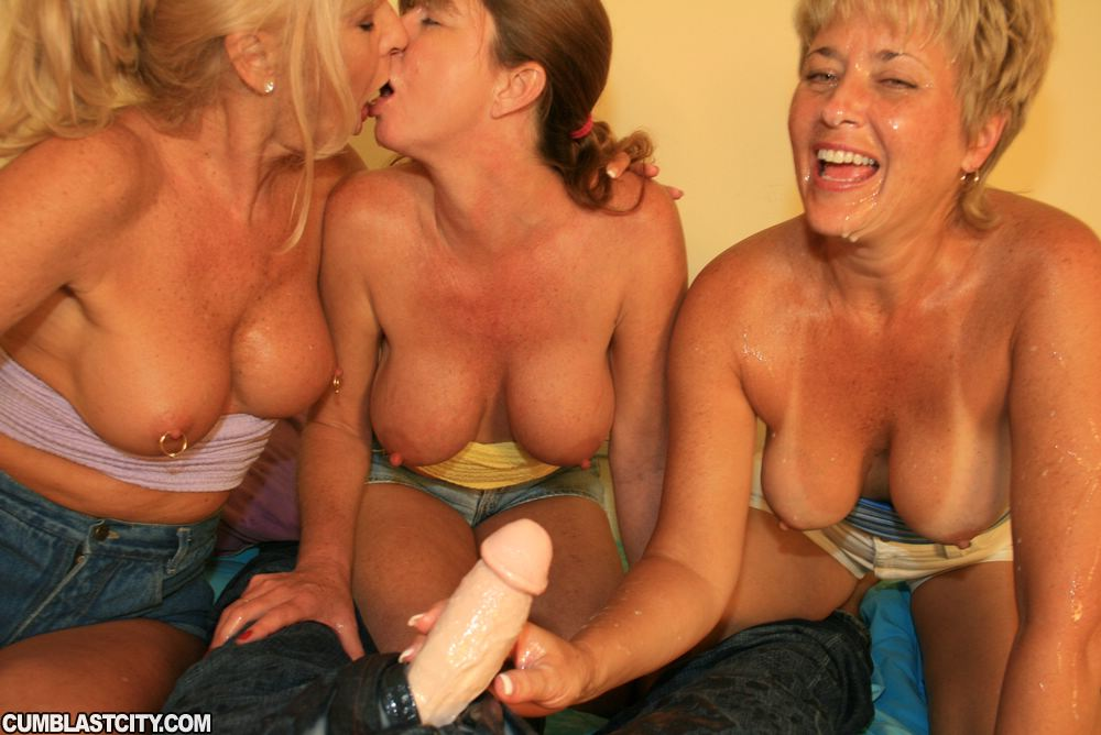 Lascivious mature ladies with big tits stroking a cock and ...
