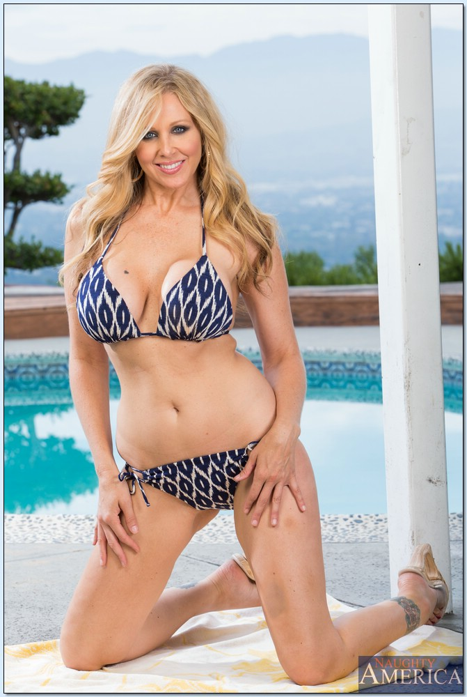 Curvaceous blonde MILF on high heels Julia Ann stripping by the pool