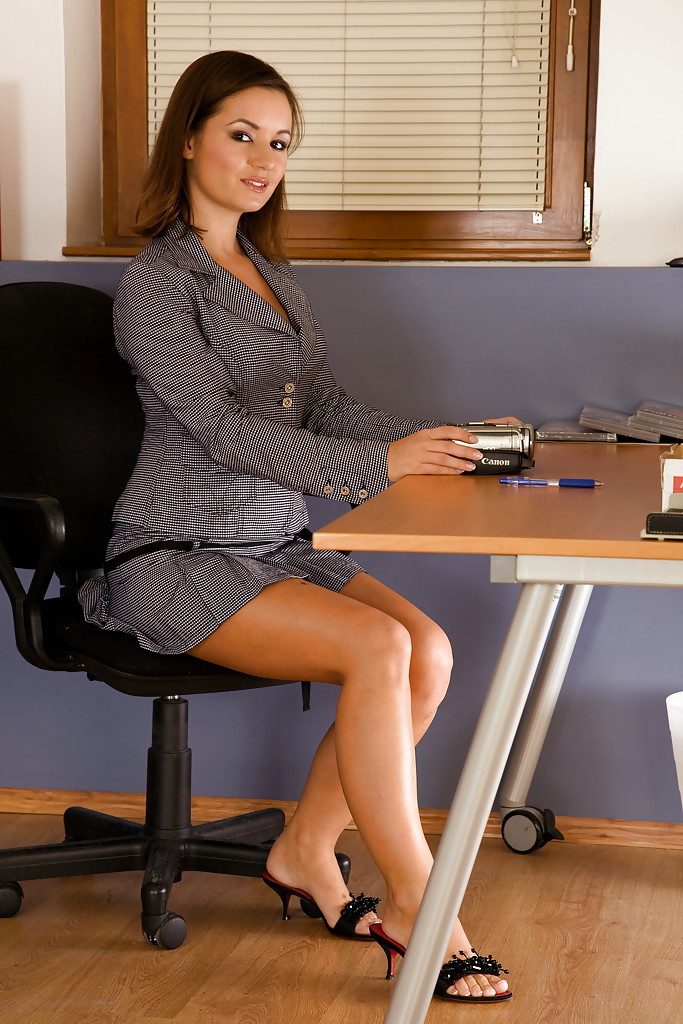 image Beautiful nici dee undressing in the office