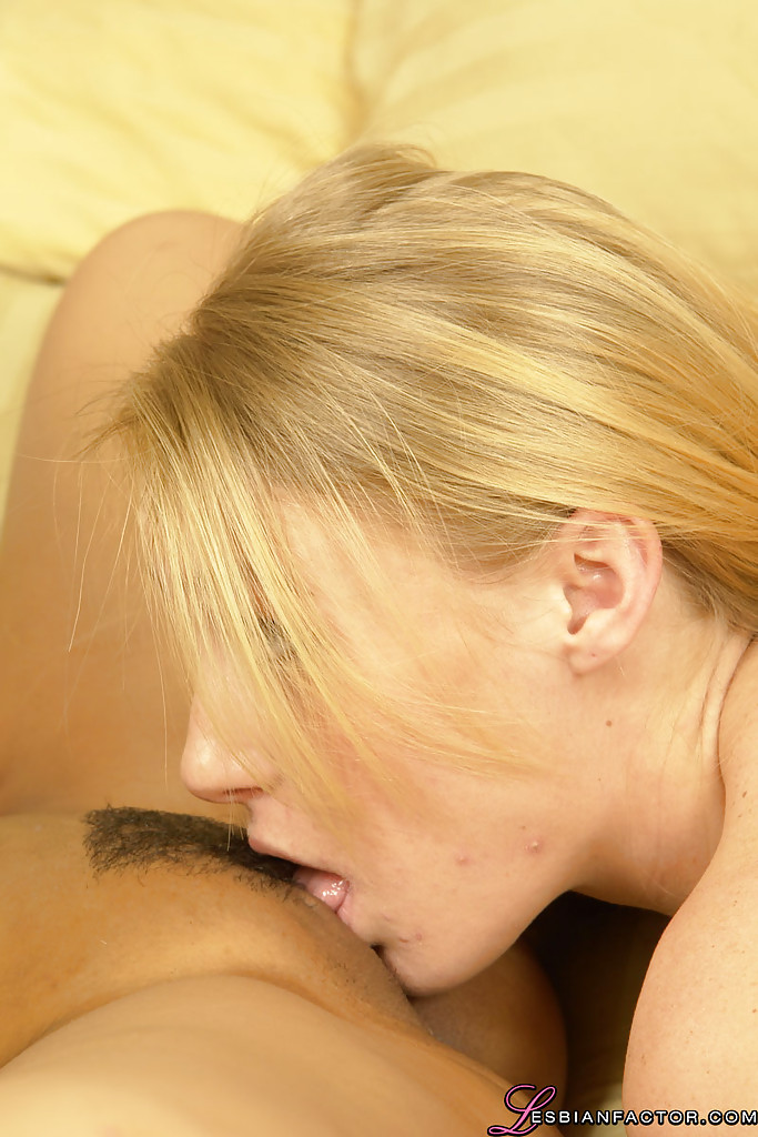 Big busted blonde having some lesbian fun with her asian friend