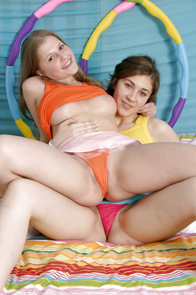 Lustful teenage lesbians stripping and fingering each other