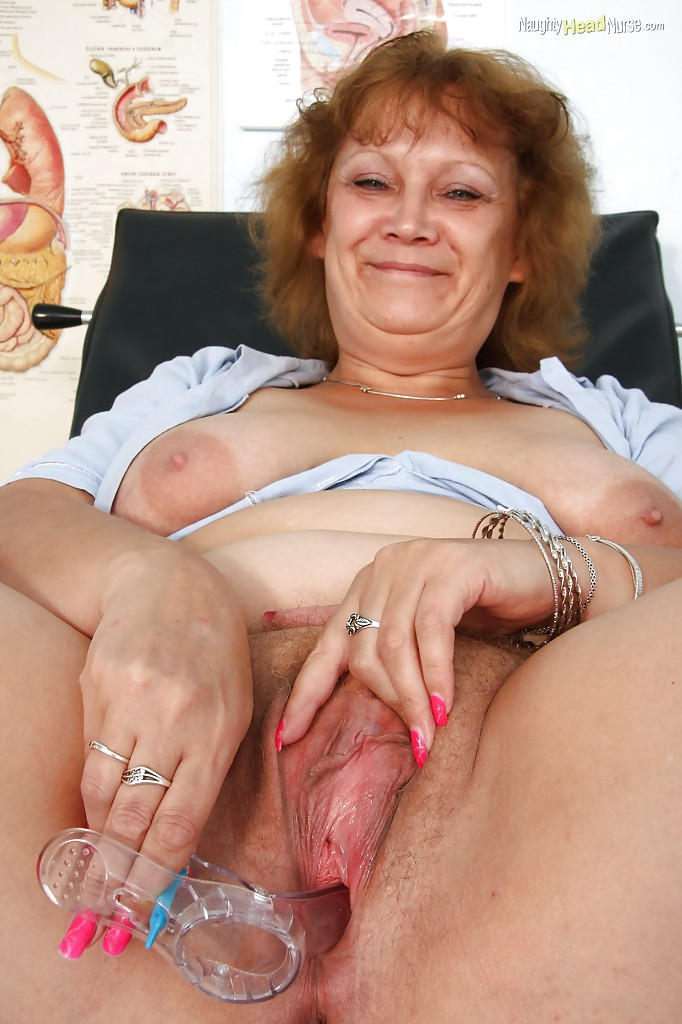Filthy mature nurse playing with a vibrator and gyno tools