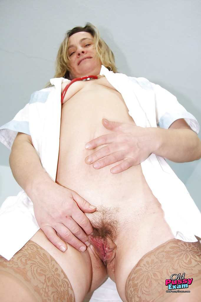 image Hairy nurse has her finger to the pulse