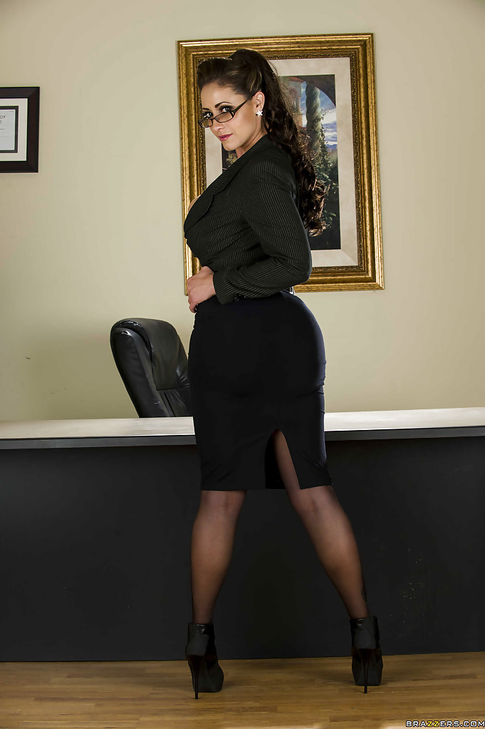 voluptuous office lady in glasses stripping off her suit