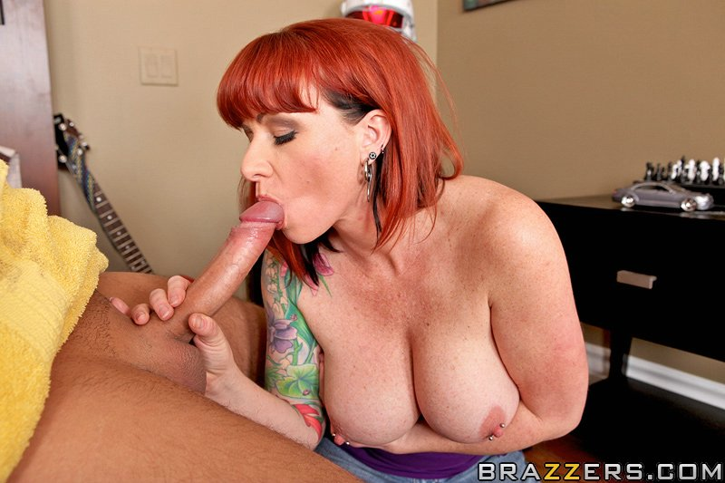 Hot tatooed milf sucking a big cock