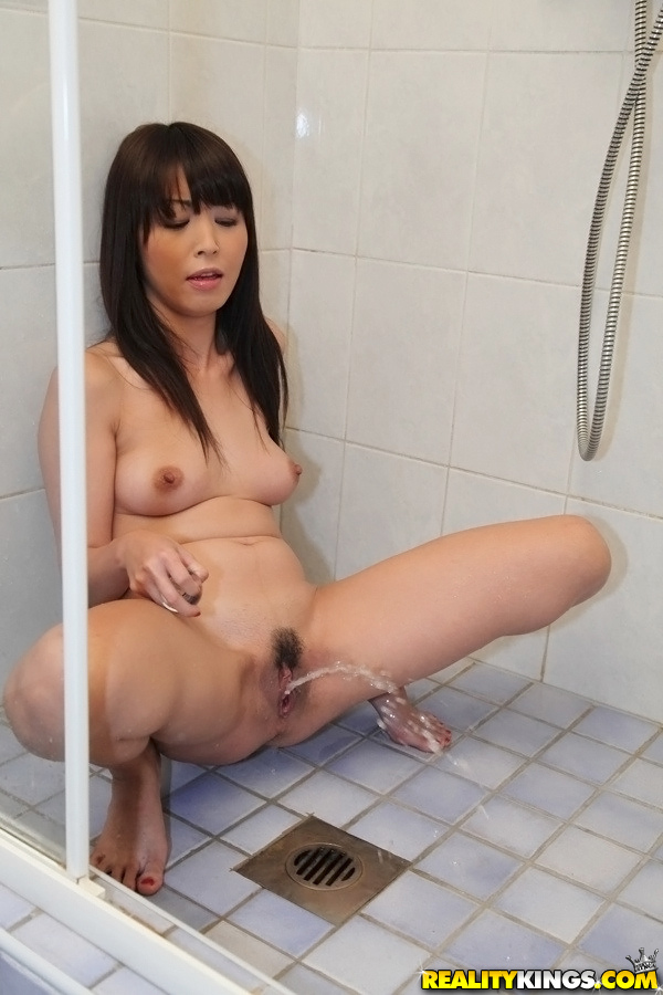 naked girl sitting on the toilet