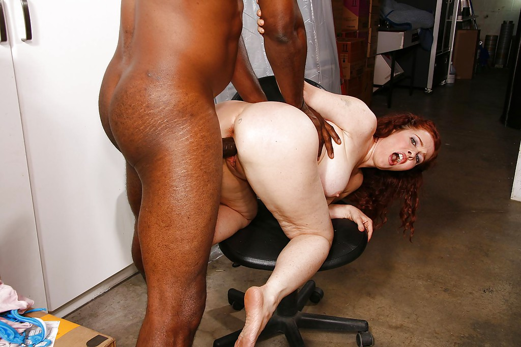 Busty redhead MILF Mae Victoria sucks and fucks a big black shaft
