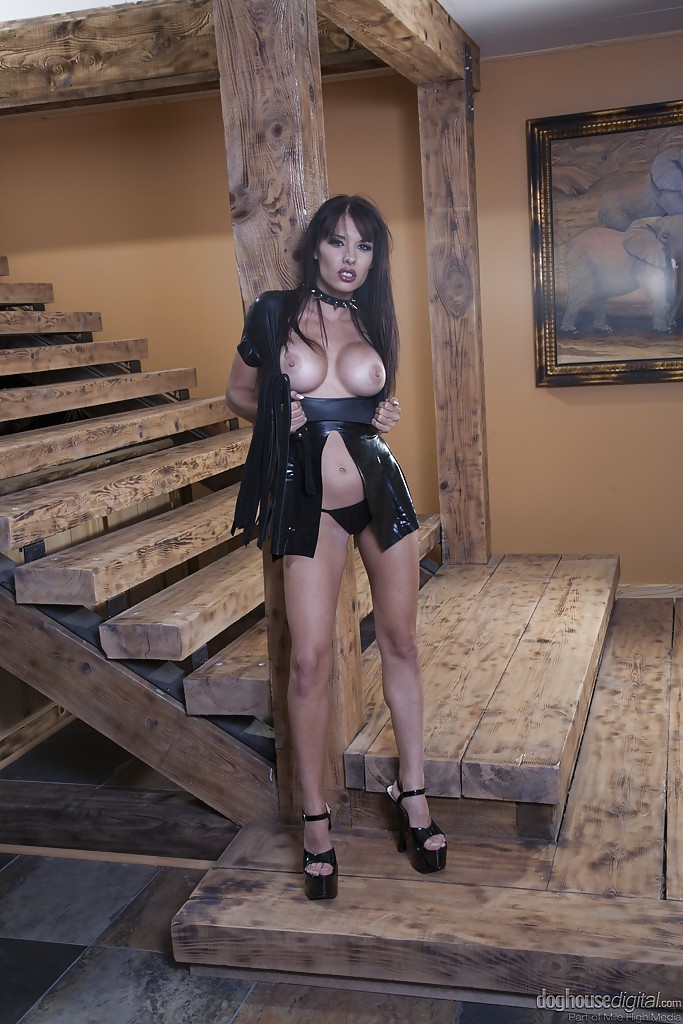 Raven-haired MILF in latex outfit revealing her big round ...