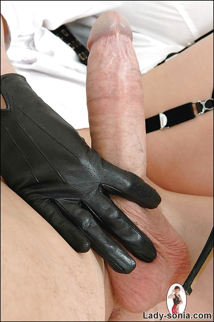 Mature fetish lady in leather gloves gives a sensual handjob to a ...