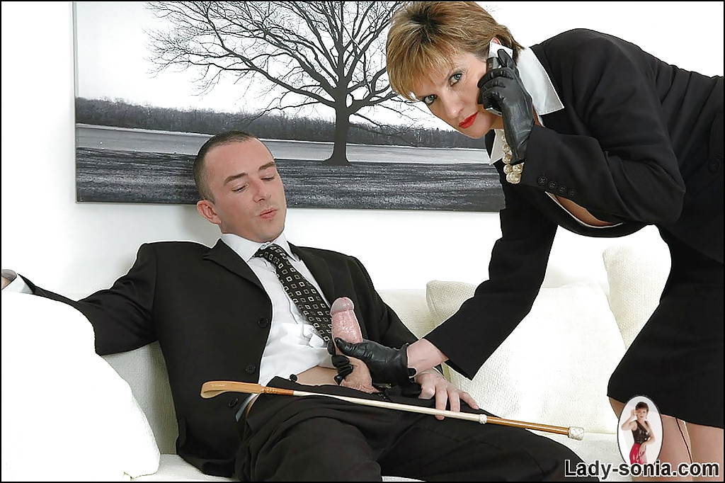 ... Fully clothed mature fetish lady in leather gloves gives a sloppy  handjob ...