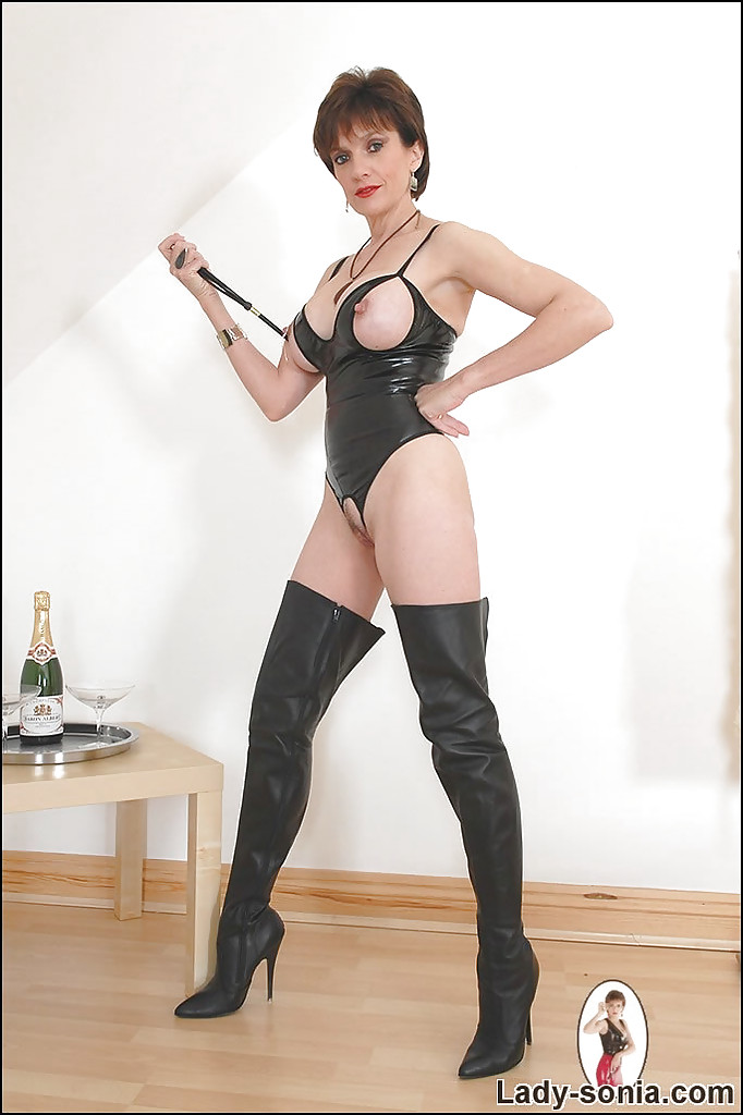 mature lady in cat suit boots