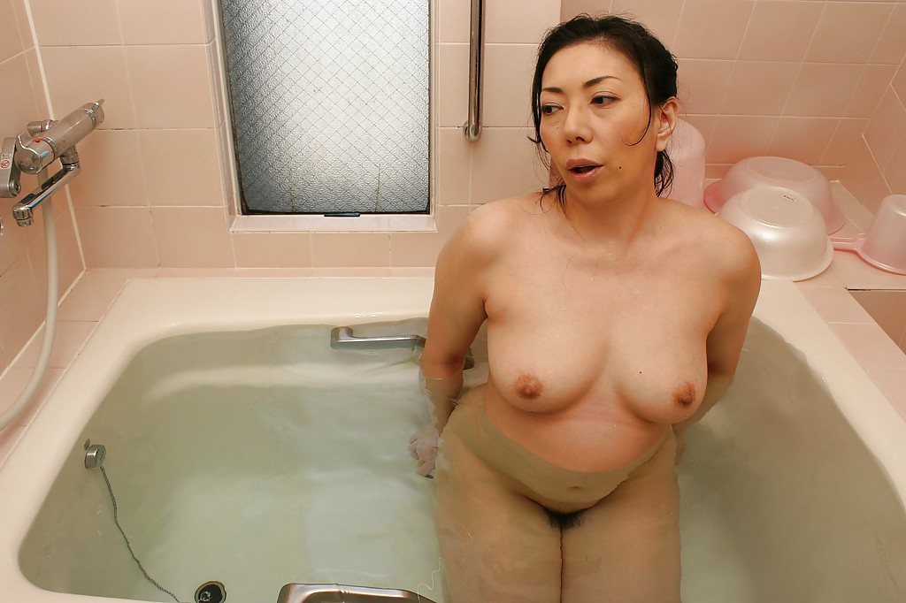 image English mature bathes her giant tits amp hairy pussy