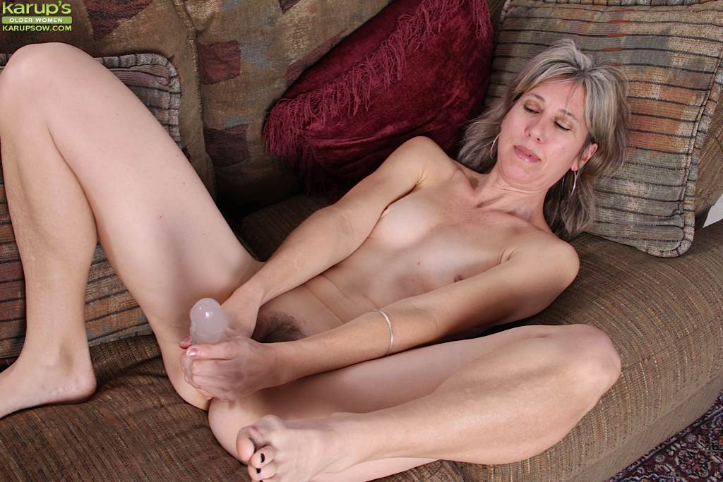 her pretty hairy pussy is toyed and fucked