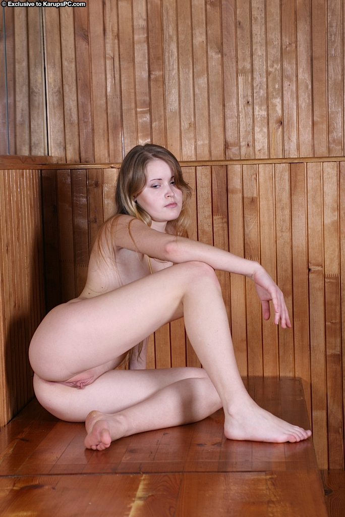 Playful amateur taking off her lingerie and exposing her body in the sauna