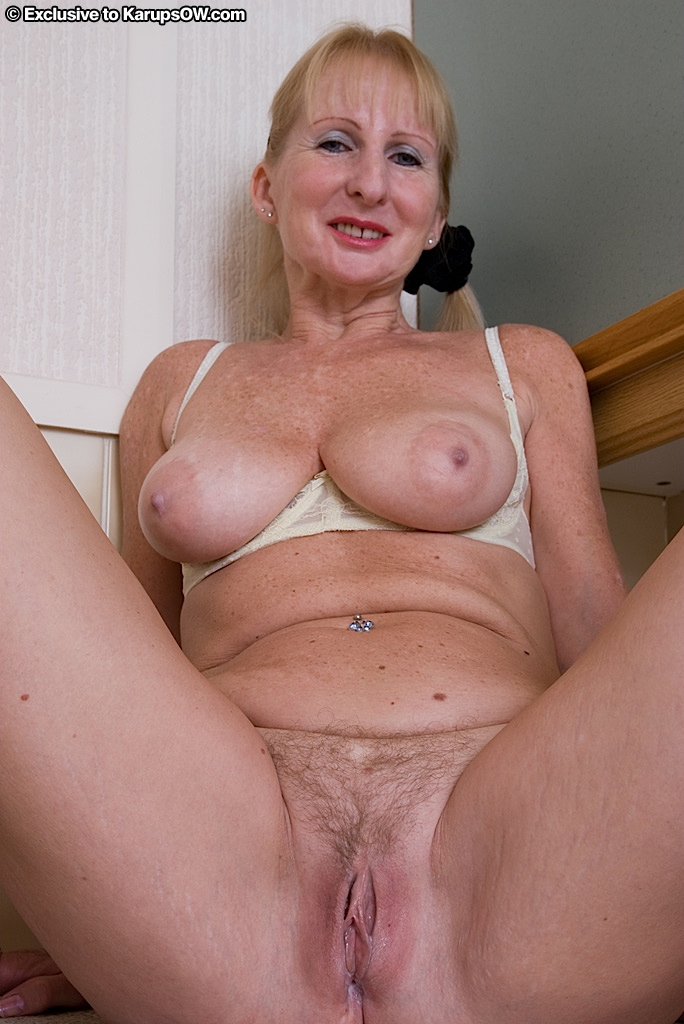 ... Ugly mature blonde in stockings revealing her massive melons and hairy  twat