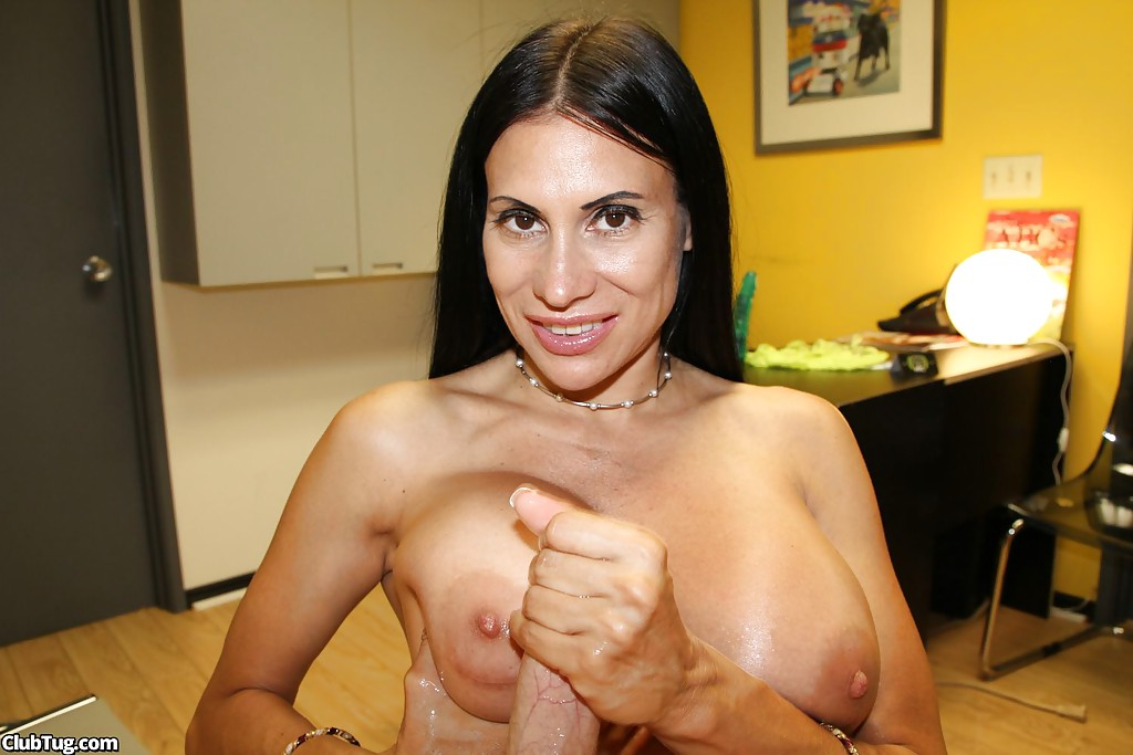 Mature gives oily handjob
