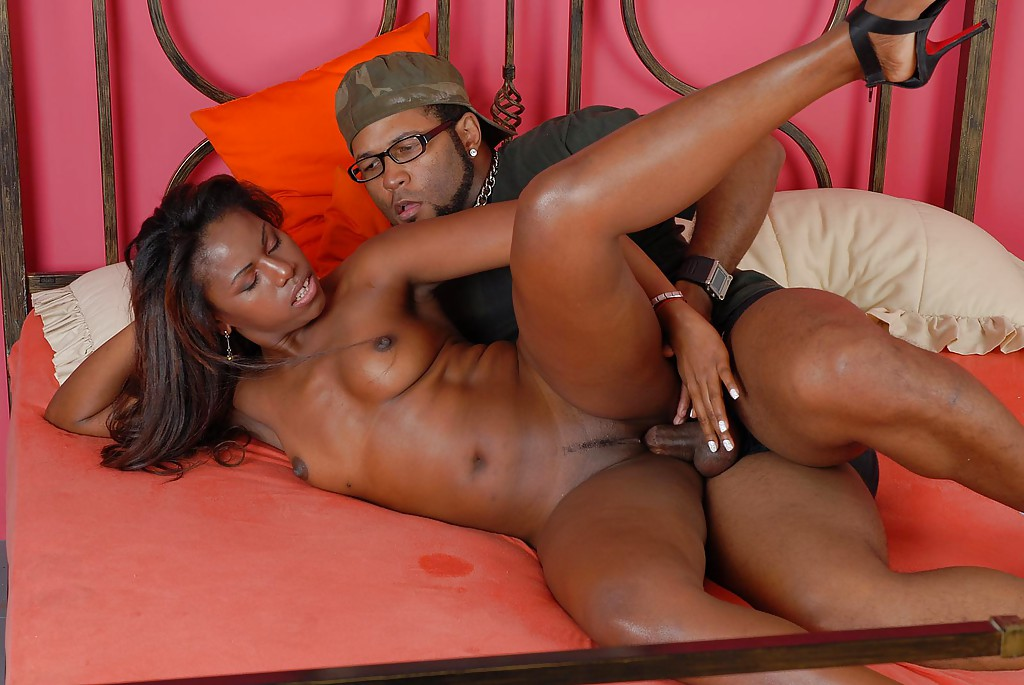 horny ebony raises legs to get fucked