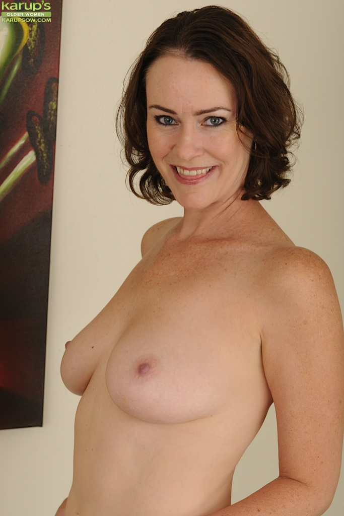 Mature vixen in dress clothes stripping down and exposing her hairy gash