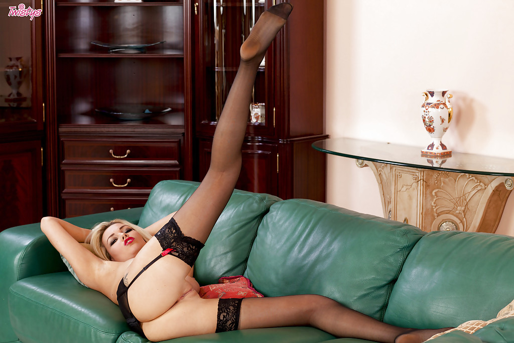 Glamorous blonde vixen in openwork stockings slowly uncovering her goods