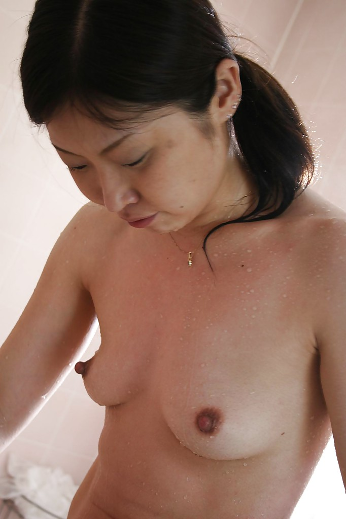 Perfect nipple Asian milf taking a shower