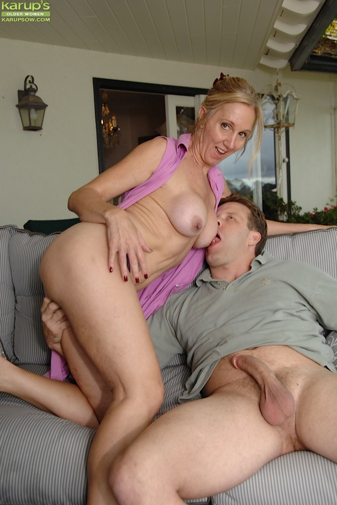 Busty woman gives her man a footjob 7