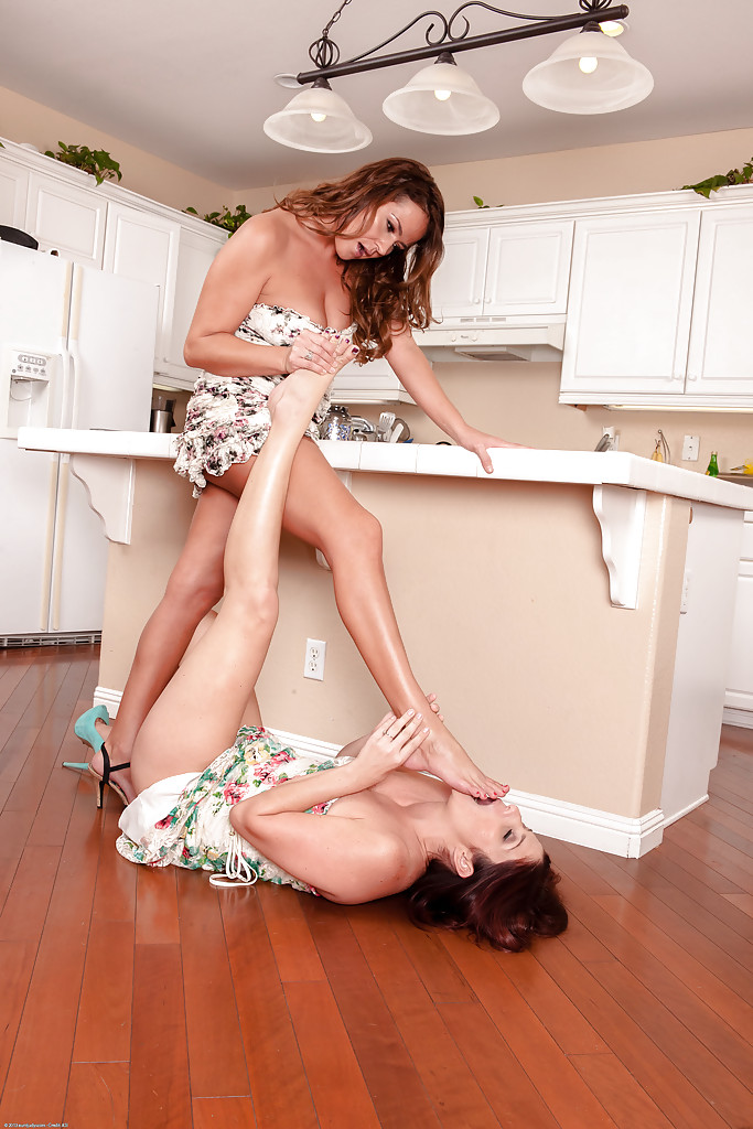Tempting brunette MILFs have some lesbian fun in the kitchen