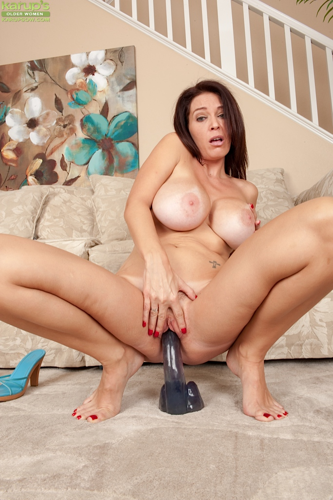 ... Lecherous top-heavy MILF with trimmed cooter riding a big dildo ...