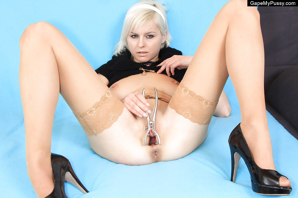 Perky blonde hottie in stockings stretching her pink pussy