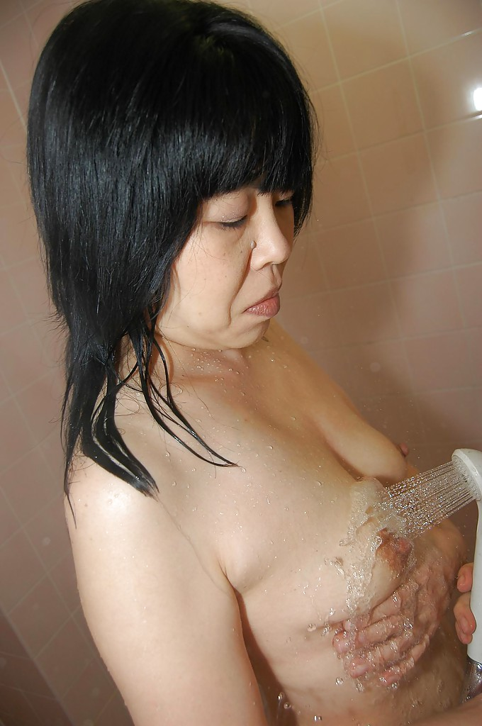 Sassy asian MILF with hairy cunt and saggy tits taking shower