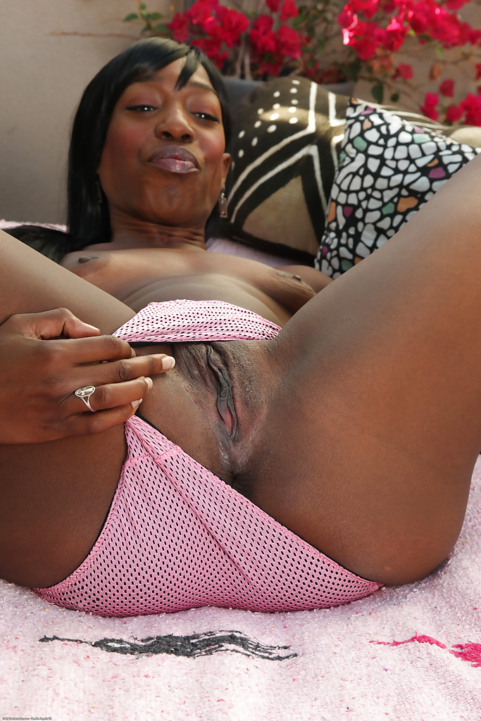 Black pussy covered with.. Ebony mature take off pink clothes and show her hairy beaver Ebony mature take off..