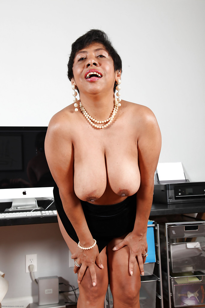 Fatty latina mature office lady revealing her jugs and twat