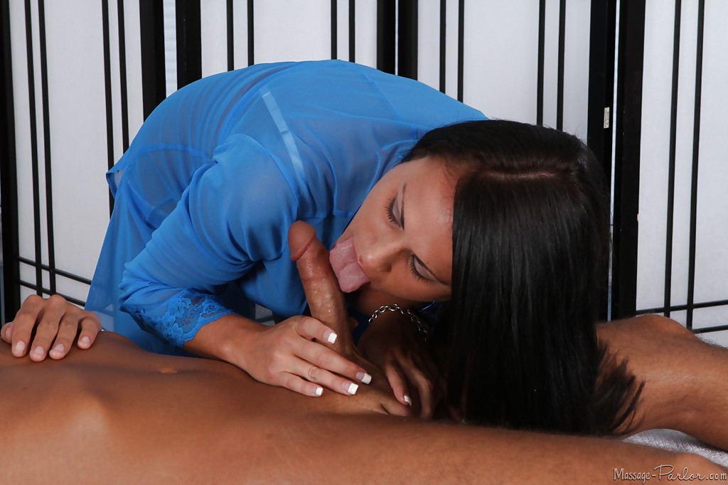 Massage by brunette Ashli Ames turns into hot blowjob in the 69 pose.
