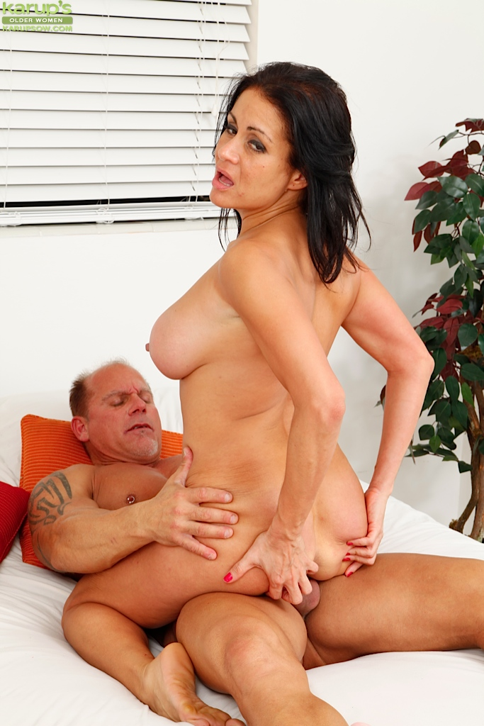 Mature with big tits riding dick