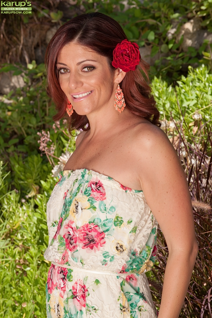Clothed milf Alicia Silver is undressing outdoor in the woods