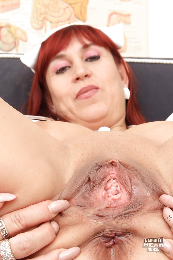 Hot red head nurse