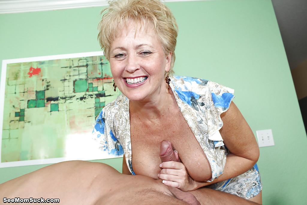 mature playing with cum