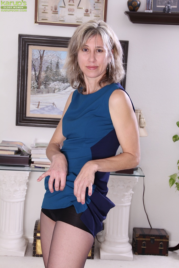 Mature caught undressing