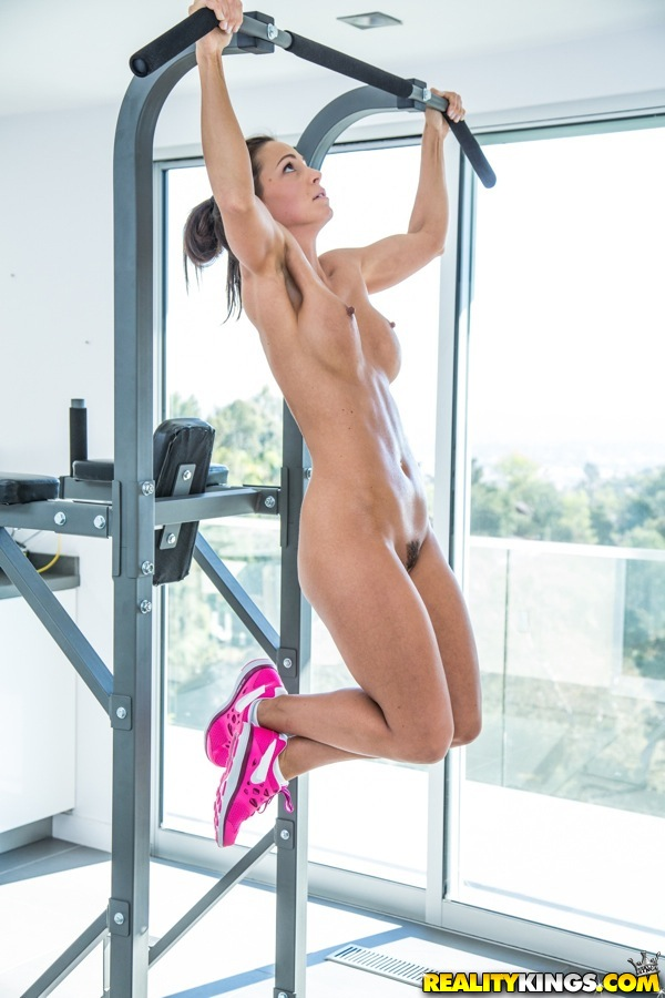 Naked girl doing pull ups