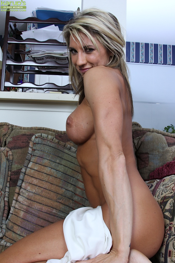 Pretty blonde milf with big tits spreading her pussy lips ...