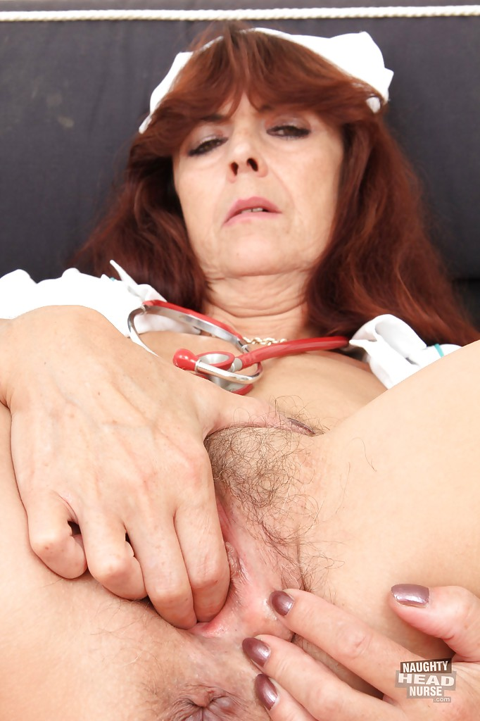 European mature babe Lada showing her hairy pink pussy